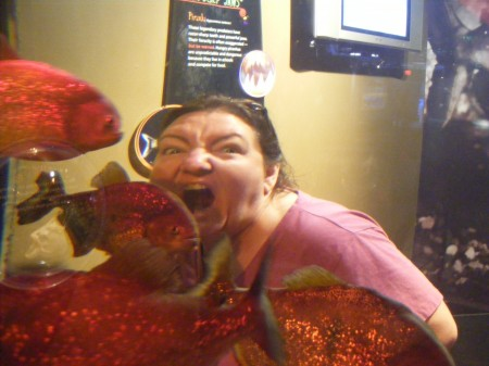 Kelly biting the piranhas!