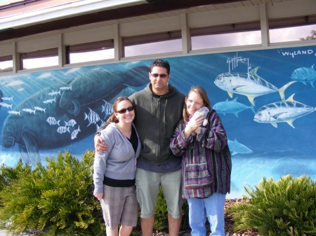 Adrianne, Phillip & Emmy in front of the Wyland mural