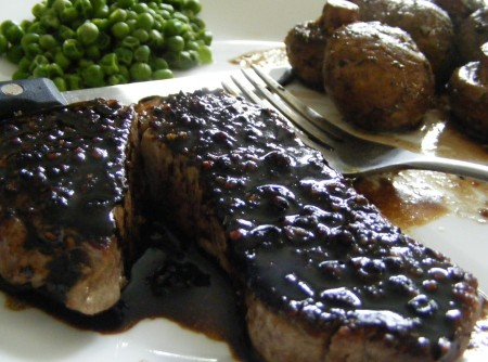 Balsamic Peppered Sirloin, Parisian Roasted Mushrooms and green peas